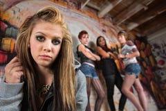Gang Intimidating Girl royalty free stock image
