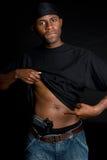 Gang Member. African american gang member with gun Royalty Free Stock Photo
