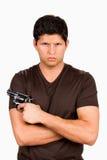 Gang Member With Gun. Serious and menacing looking gang member holds a gun Stock Image