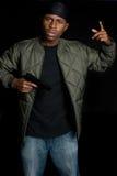 Gang Member Holding Gun. Black gang member holding gun Royalty Free Stock Photography