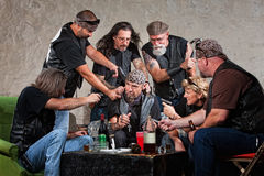 Gang Members Threaten a Man. Biker gang members threatening men in bandana Royalty Free Stock Images