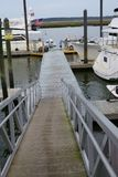 Boat dock gang plank. Gang plank leading down to the boat docks for easy access for loading and unloading boats royalty free stock photos