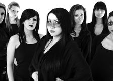 Gang of seven women. Gang of seven young women dressed in black looking at camera Stock Photo