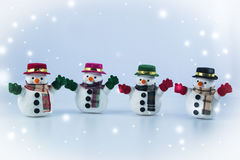 Gang of Snowman stand on white background. Royalty Free Stock Images