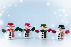 Gang of Snowman stand on white background. Royalty Free Stock Photo