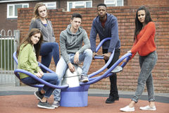 Gang Of Teenagers Hanging Out In Children's Playground Royalty Free Stock Photo