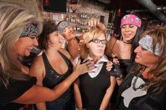 Gang Touching Nerd's Hair Stock Image