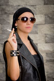 Gang woman smokes on the street, selective focus Royalty Free Stock Images