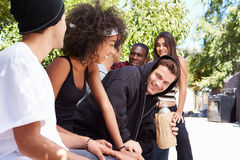 Gang Of Young People In Urban Setting Drinking Alcohol Royalty Free Stock Images