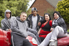 Gang Of Youths Sitting On Cars royalty free stock image