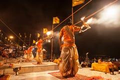Ganga Aarti ritual. VARANASI, INDIA - APRIL 11: An unidentified Hindu priest performs religious Ganga Aarti ritual (fire puja) at Dashashwamedh Ghat on April 11 Stock Photography