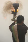 Ganga Aarti in Varanasi. A priest at Dashashwamedh ghat performs daily Agni Pooja (Worship to Fire) wherein a dedication is made to Lord Shiva, River Ganga (the Stock Photography
