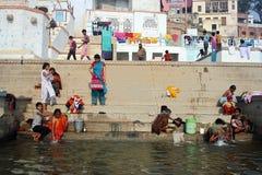 Ganga River at Benaras. February 10,2012 Benaras,Uttar Pradesh,India,Asia- Local people bathing in the River Ganges at Varanasi, India Stock Photography