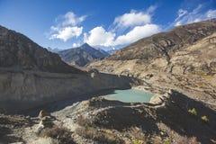 Gangapurna lake in Himalaya mountains in Nepal. Gangapurna lake with turquoise water in Himalaya mountains in Nepal royalty free stock photos