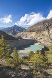 Gangapurna lake in Himalaya mountains in Nepal. Gangapurna lake with turquoise water in Himalaya mountains in Nepal stock photos