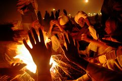 Gangasagar Festival In India. January 14, 2009-Ganga sagar, West Bengal, India - AT THE EVENING DEVOTEES ARE GATHER FOR HOT FORMENTATION DUE TO COLD WEATHER stock images