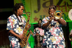 Gangbe Brass band. CANARY ISLANDS - JULY 8: Vodounnon James & Ahouandinou W. Martial from Gangbe Brass Band, from Cotonou-Benin in Africa, performing onstage Stock Image