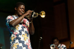 Gangbe Brass Band. CANARY ISLANDS - JULY 8:A musician from Gangbe Brass Band, from Cotonou-Benin in West Africa, performing onstage during Festival Canarias Jazz Royalty Free Stock Photo
