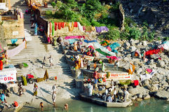 Ganges Colorful laundry, India. Indian people hanging colorful laundry on the shore of the Ganges river, Rishikesh, India royalty free stock photo