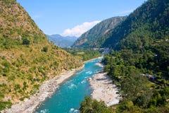 Ganges flod i Himalayasberg Fotografering för Bildbyråer