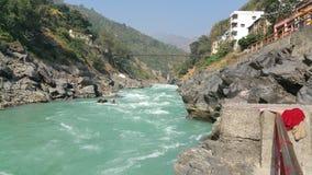 Beautiful Ganges river flows through Rishikesh, India. royalty free stock photos