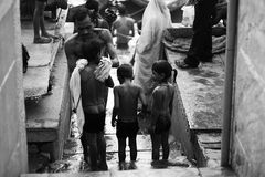 Ganges in India. Ganges, India, a father of three children a bath stock image