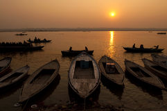 Ganges River. A stunning sunrise looking over the holiest of rivers in India. The Ganges. Silhouettes of boats dapple the horizon royalty free stock photography
