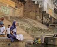 A woman is sitting quietly in the Ganges in the early morning. royalty free stock photos
