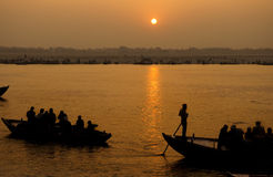 The Ganges River, India. A stunning sunrise looking over the holiest of rivers in India. The Ganges. Silhouettes of boats dapple the horizon royalty free stock photos