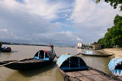 Ganges River In Kolkata. Ferry boats on the river Ganges (Hooghly)during the rainy season in Kolkata (Calcutta), West Bengal, India. The 2,510 km Ganges river Royalty Free Stock Images