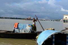 Ganges River In Kolkata. Ferry boats on the river Ganges (Hooghly)during the rainy season in Kolkata (Calcutta), West Bengal, India. The 2,510 km Ganges river Stock Photo