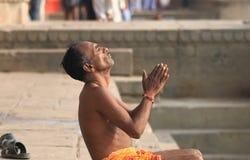 Ganges river meditation Varanasi India. Indian man prays in Ganges river ghat in Varanasi India Royalty Free Stock Photography