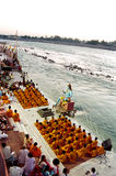 Ganges River Puja Ceremony, India. Puja Ceremony on the Ganges river with long exposure emphasizing the water flow and prayer movements, Rishikesh, India stock photography