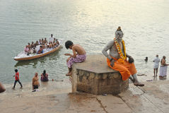 Ganges River. A sadhu on a ghats of varanasi.Huge crowds of pilgrims and visitors from all parts of the world gather to take part in this ancient ritual place Royalty Free Stock Image
