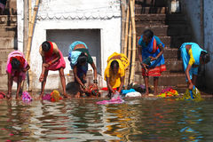 Ganges river. VARANASI - 2 MARCH : Hindu people wash themselves in the river Ganga in the holy city of Varanasi. The holy ritual of washing is held every day Royalty Free Stock Photo