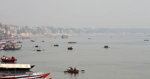 Ganges river in winter. Sacred river Ganges in winter. Magnificent places with wide outlook of Holy city Varanasi, great Asian river, shuttles and ships, endless stock images