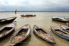 The Ganges river. Wooden boats floating on the Ganges River in Varanasi Royalty Free Stock Images