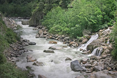 Ganges stream and waterfall. Small tributary and stream pouring into a young river ganga  before it becomes a huge vast river downstream Royalty Free Stock Image
