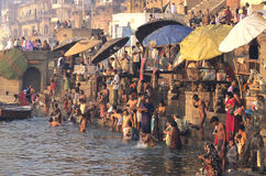The Ganges In Varanasi. Hindu people taking a ritual bath in the holy Ganges River in Varanasi (Benares), North India Stock Photo