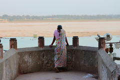 GangesView. An Indian lady looks out over the River Ganges in Varanasi, Northern India Royalty Free Stock Photography