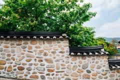 Ganghwa island old village, Korean traditional stone wall with green trees in Incheon, Korea