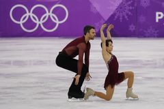Bronze medalists  Meagan Duhamel and Eric Radford of Canada perform in the Pair Skating Free Skating at the 2018 Winter Olympics. GANGNEUNG, SOUTH KOREA Stock Image