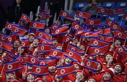 North Korea`s cheering squad perform during Pair Skating Free Skating in Gangneung Ice Arena at the 2018 Winter Olympics. GANGNEUNG, SOUTH KOREA - FEBRUARY 15 royalty free stock photo