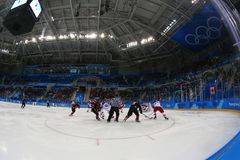 Team Canada in action against Team Czech Republic during Men`s ice hockey preliminary round game at 2018 Winter Olympic Games. GANGNEUNG, SOUTH KOREA - FEBRUARY Royalty Free Stock Image