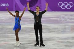 Vanessa James and Morgan Cipres of France perform in the Team Event Pair Skating Short Program at the 2018 Winter Olympic Games. GANGNEUNG, SOUTH KOREA Royalty Free Stock Images