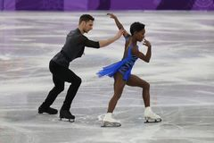 Vanessa James and Morgan Cipres of France perform in the Team Event Pair Skating Short Program at the 2018 Winter Olympic Games. GANGNEUNG, SOUTH KOREA Royalty Free Stock Image