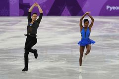 Vanessa James and Morgan Cipres of France perform in the Team Event Pair Skating Short Program at the 2018 Winter Olympic Games. GANGNEUNG, SOUTH KOREA Royalty Free Stock Photography