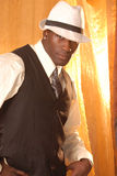 Gangster. Brooding african american male with white fedora an vest Royalty Free Stock Images
