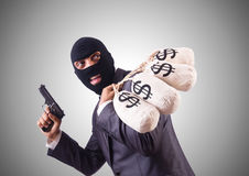 Gangster with bags of money against the gradient Royalty Free Stock Images