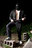 Gangster with baton outdoors at night Royalty Free Stock Images